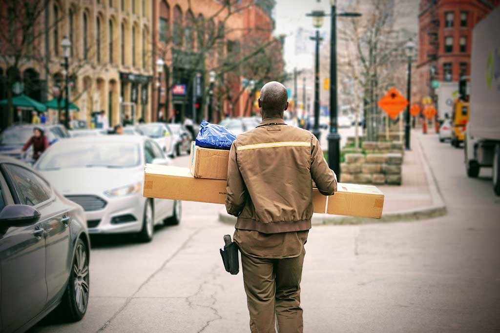 delivery man Photo by Maarten van den Heuvel on Unsplash